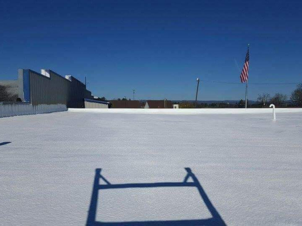 Enjoy the benefits of a flat roof for your business
